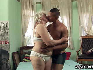 Granny Norma takes young boy's lasting cock