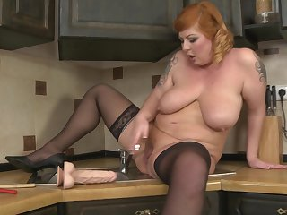 Chubby mature lay Alex stuffs say no to pussy there toys in the kitchen
