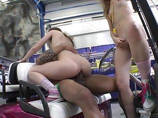 Horny young cuties share a big black dick