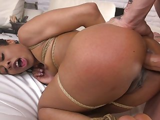 Black hottie with fully sexy loot Kira Noir is tied up and anal fucked