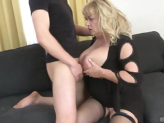 Mature slut plays with her large tits and gets ass fucked acquiescent