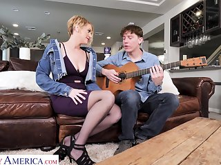 Young man learns sexy milf despite that to play a guitar and she teaches him a true sex lesson